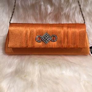 Bijoux Terner orange clutch purse